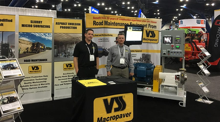 The World of asphalt - Joe Brandenburg and Doug Hogue at the VSS Macropaver booth with the XD 100SX Emulsion Plant Mill Skid: